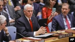U.S. Vice President Mike Pence, center, addresses a meeting on Venezuela in the United Nations Security Council at U.N. headquarters, April 10, 2019.