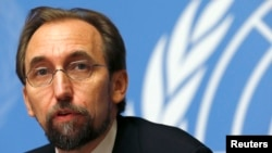 FILE - Jordan's Prince Zeid Ra'ad al-Hussein, U.N. High Commissioner for Human Rights, pauses during a news conference at U.N. European headquarters in Geneva, Oct. 16, 2014.