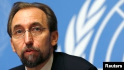 FILE - Zeid Ra'ad al-Hussein, U.N. High Commissioner for Human Rights, pauses during a news conference at U.N. European headquarters in Geneva, Oct. 16, 2014.