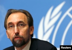 FILE - Jordan's Prince Zeid Ra'ad Zeid al-Hussein, U.N. High Commissioner for Human Rights, pauses during a news conference at U.N. European headquarters in Geneva, Oct. 16, 2014.