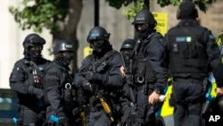 Near the start of a training exercise for London's emergency services, armed police officers stand near the disused Aldwych underground train station in London, June 30, 2015.