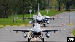 Belgiyaning F-16 qiruvchi samolyotlari koalitsiyaga yordam beradi.