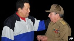 In this picture released Tuesday, Dec. 11, 2012 by Cuba's state newspaper Granma, Cuba's President Raul Castro, right, receives Venezuela's President Hugo Chavez at the Jose Marti International Airport in Havana, Cuba on Dec. 10, 2012.