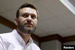 FILE - Russian anti-corruption campaigner and prominent opposition figure Alexei Navalny is seen attending a hearing at the Moscow City Court in Moscow, Russia, Feb. 12, 2016.