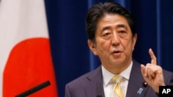 Japan's Prime Minister Shinzo Abe speaks during a press conference at his official residence in Tokyo May 14, 2015. (AP Photo/Shizuo Kambayashi)