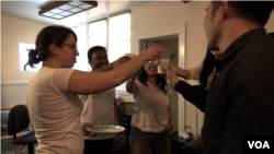 A champagne celebration marked the first $500 in revenue at Cloud of Goods, a website that links San Francisco-area residents to tourists who need to rent household items that were too bulky to bring on their journey. (M. O'Sullivan/VOA)