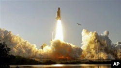 Space shuttle Discovery - the world's most traveled spaceship - thunders into orbit for the final time as it heads toward the International Space Station on a journey that marks the beginning of the end of the shuttle era, at the Kennedy Space Center in C