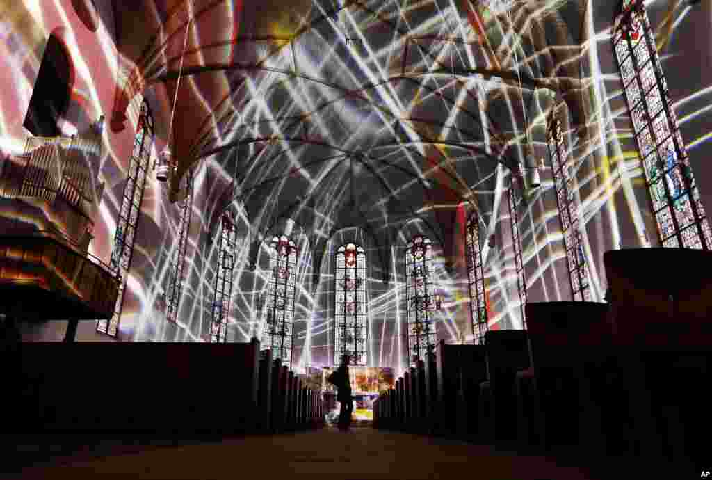 "The inside of the Katharinen church is illuminated during a rehearsal for the ""Luminale"" light festival in Frankfurt, Germany."
