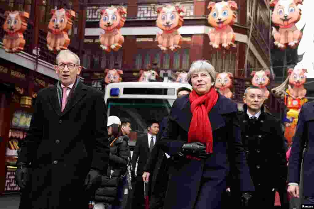 بازدید ترزا می، نخست وزیر بریتانیا به همراه همسرش از باغ یویوان شانگهای چین