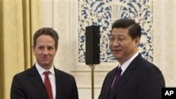 中国副主席习近平(右)1月11日在北京会见到访的美国财政部长盖特纳