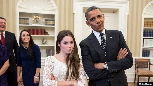 "President Barack Obama jokingly mimics U.S. Olympic gymnast McKayla Maroney's ""not impressed"" look while greeting members of the 2012 U.S. Olympic gymnastics teams in the Oval Office, Nov. 15, 2012."