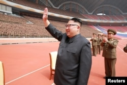North Korean leader Kim Jong Un waves to the members of the Korean People's Army in this undated photo released by North Korea's Korean Central News Agency, May 13, 2017.