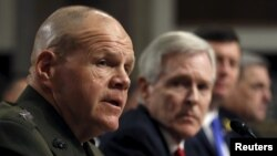 FILE - Commandant of the U.S. Marine Corps Gen. Robert Neller (L) testifies during a Senate Armed Services Committee hearing on Capitol Hill in Washington, Feb. 2, 2016.