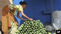 A vendor arranges cucumbers at a market in Abidjan (file photo)