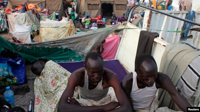 Displaced men rest in an improvised shelter at Tomping camp, where some 17,000 displaced people who fled their homes after violence erupted in South Sudan's capital Juba in mid-December are being sheltered by the United Nations, in Juba Jan. 10, 2014.