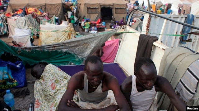 Displaced men rest in an improvised shelter at Tomping camp, where some 17,000 displaced people who fled their homes after violence erupted in South Sudan's capital Juba in mid-December are being sheltered by the United Nations, in Juba, Jan. 10, 2014.