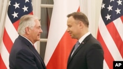 FILE - Rex Tillerson, U.S. Secretary of State, meets with Polish President Andrzej Duda, during a visit to Warsaw, Poland, Jan. 26, 2018.