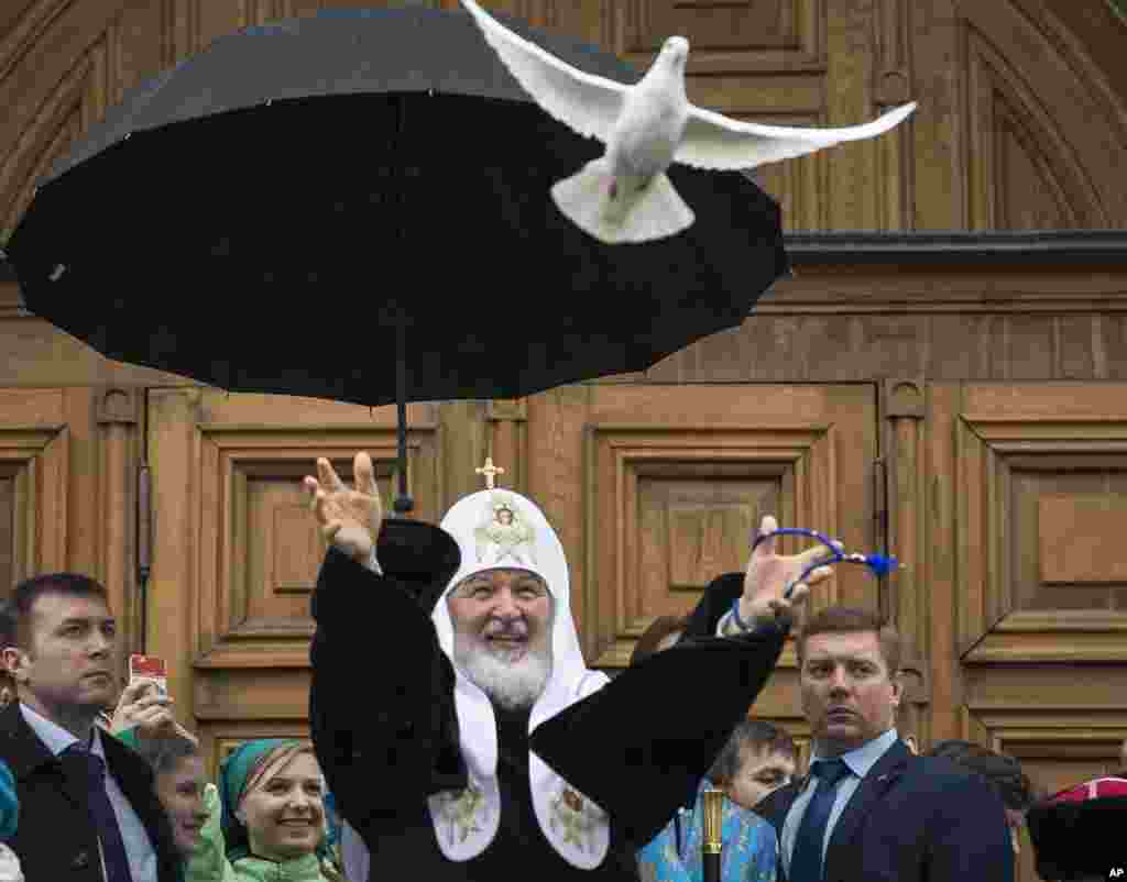 Russian Orthodox Church Patriarch Kirill, center, releases birds at the Annunciation Cathedral in Moscow's Kremlin to mark the Russian Orthodox holiday of the Annunciation.