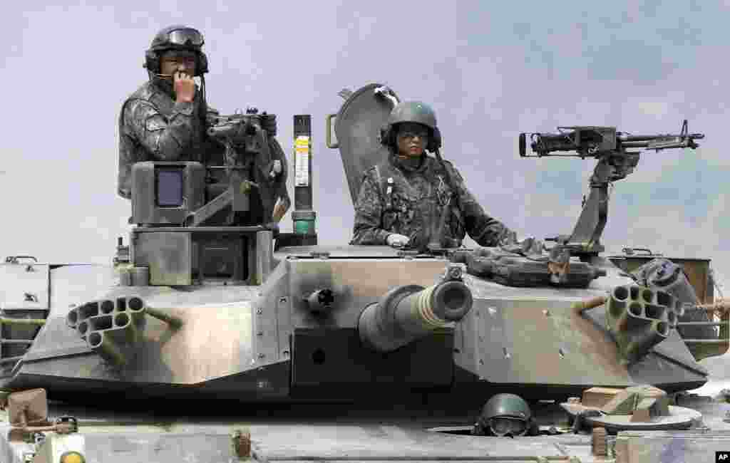 South Korean army soldiers man their K1 tank after a live firing drill at the U.S. Army's Rodriguez range in Pocheon, South Korea.