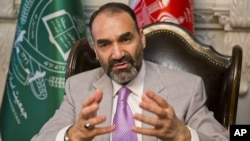FILE - Atta Mohammad Noor, governor of the Balkh province, talks during an interview with The Associated Press at his home in Kabul, Afghanistan, Aug. 3, 2015.