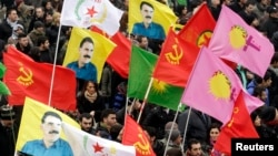 FILE - Kurds take part in a demonstration calling for the release of Kurdistan Workers Party [PKK] leader Abdullah Ocalan, in Strasbourg, eastern France, Feb. 16, 2013.