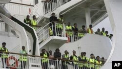 Bangladeshi immigrants evacuated from Libya are seen on the deck of the ferry 'Ionian King' docked inside Souda port in Crete, Greece, March 6, 2011