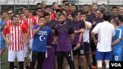 The teams taking part in the 2018 Uyghur American Cup line up before play begins.