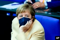 German Chancellor Angela Merkel listens to a debate about the situation in the country ahead of the upcoming national election in Berlin, Sept. 7, 2021.
