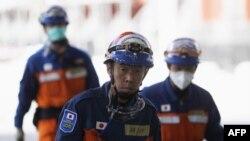 Nhân viên cứu hộ Nhật Bản tại tòa nhà CTV bị sụp đổ ở Christchurch, New Zealand, ngày 24/2/2011