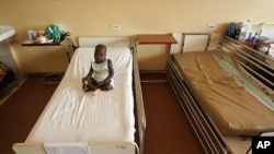 FILE - A sick child in a Dakar hospital.