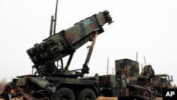 A camouflaged convoy of Dutch military trucks carrying two batteries of Patriot missiles is lined up for a media opportunity before departing De Peel Air Base in Vreedepeel, southern Netherlands, Jan. 7, 2013.