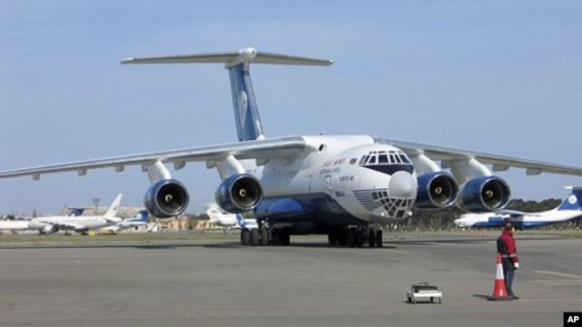 In this undated photo provided by Silkway Airlines press service on Wednesday, July 6, 2011, the IL-76TD-90SW cargo plane, similar to the one crashed in Afghanistan, is seen in an undisclosed location