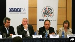 The panel of the international observers, during a news conference, in Tirana, Albania, Monday, June 24, 2013. International observers monitoring Albania's weekend parliamentary election said on Monday the vote was an improvement to past fraud-rigged