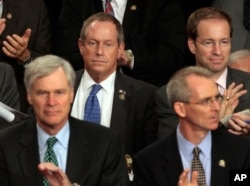 "FILE - Rep. Joe Wilson, R-S.C., center, listens during President Barack Obama's speech on health care to a joint session of Congress on Capitol Hill in Washington, Sept. 9, 2009. During the address, Wilson shouted, ""You lie!"""