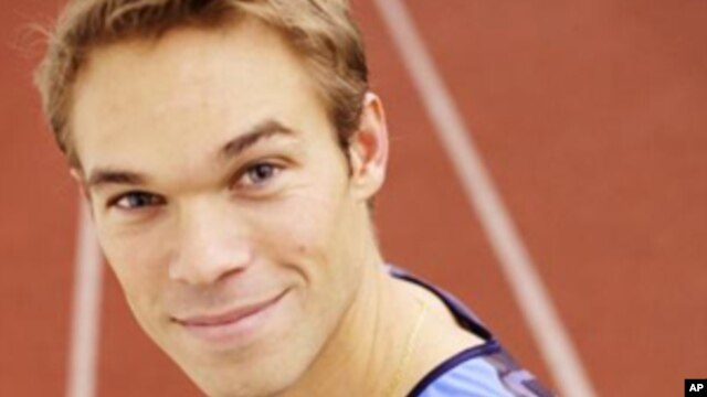 Olympian Nick Symmonds sports the Hanson Dodge Creative logo, after the company won an eBay auction on his left shoulder.