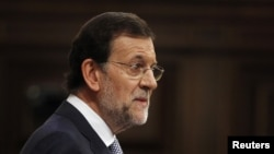 Spain's Prime Minister Mariano Rajoy gestures during a parliamentary session in Madrid, July 11, 2012.