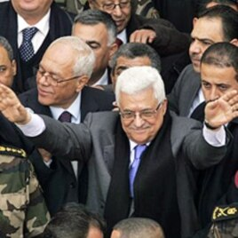 Palestinian President Mahmoud Abbas, center, gestures during a rally in the West Bank city of Ramallah, 25 Jan 2011
