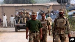 Pakistan army soldiers arrive at the mosque attacked by suicide bomber in Darra Adam Khel, 35 kilometer (21 miles) south of Peshawar, Pakistan, 05 Nov 2010