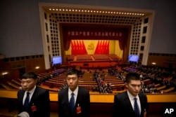 Security personnel stand guard after the opening session of China's 19th Party Congress at the Great Hall of the People in Beijing, Oct. 18, 2017.
