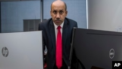FILE - Ali AlAhmed poses for a photograph in his office in Washington, Oct. 26, 2018.