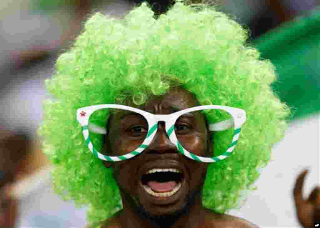 A Nigeria fan reacts at the end of the African Cup of Nations final at the Soccer City Stadium in Johannesburg, South Africa, Sunday, Feb. 10, 2013. Nigeria defeated Burkina Faso 1-0 to take the trophy. (AP Photo/Armando Franca)