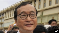 Cambodian opposition party leader Sam Rainsy, stands in front of the municipal court in Phnom Penh, Cambodia.
