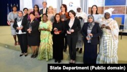 U.S. Secretary of State John Kerry and U.S. Ambassador-at-Large for Global Women's Issues Cathy Russell pose for a photo with the 2016 Secretary of State's International Women of Courage Award winners at the U.S. Department of State in Washington, D.C., o