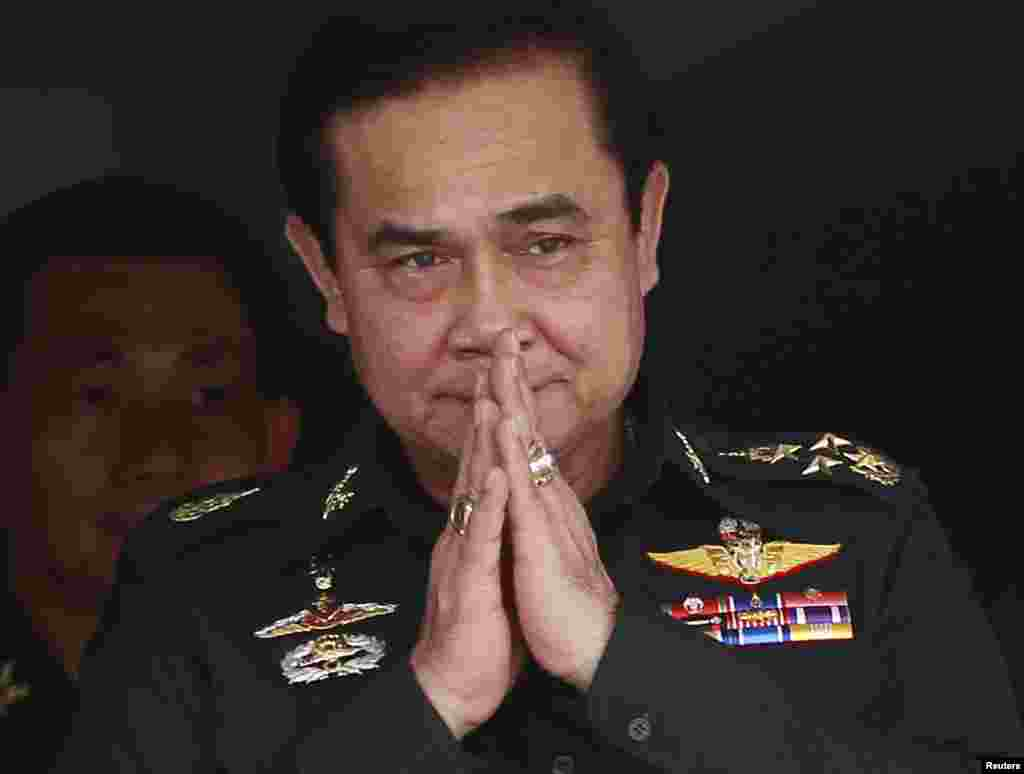 Thailand's newly appointed Prime Minister Prayuth Chan-ocha gestures in a traditional greeting during his visit to the 2nd Infantry Battalion, 21st Infantry Regiment, Queen's Guard in Chonburi province, on the outskirts of Bangkok Aug. 21, 2014.