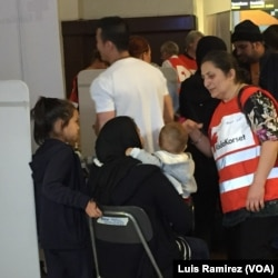 Swedish volunteer medics help migrants at Stockholm Central Station railway, Sept. 21, 2015.