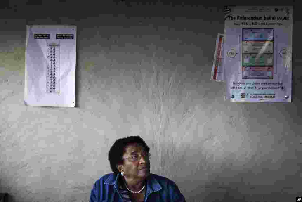 Nobel Peace Prize Laureate and incumbent leader Ellen Johnson-Sirleaf sits at a resident's home after voting during presidential elections at her home village of Fefee outside the capital Monrovia November 8, 2011. Rising tension, a planned opposition boy