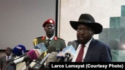 South Sudanese President Salva Kiir (R), shown delivering a speech to lawmakers, has retracted a statement that was widely perceived as a threat against journalists.
