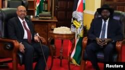 南苏丹总统基尔(右)与苏丹总统巴希尔在南苏丹首都朱巴会面。(2014年1月6日)