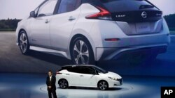 FILE - Nissan unveils its new Leaf electric vehicle during the world premiere in Chiba, Japan, Sept. 6, 2017.