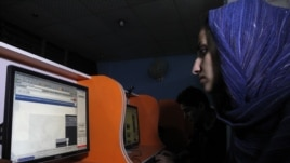 An Afghan woman browses the YouTube website at a public internet cafe in Kabul. Like Afghanistan, Indonesia seeks to ban the YouTube website showing a U.S.-made film insulting the Prophet Mohammad, Sept. 12, 2012.